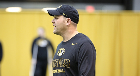 Mizzou Football Defensive Coordinator Barry Odom coaches players at Mizzou Football's Winning Edge Program on Tuesday, Feb. 10, 2014 at the Dan Devine Indoor Facility.