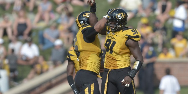Sep 5, 2015; Columbia, MO, USA; Missouri Tigers defensive end Charles Harris (91) is congratulated by safety Brock Bondurant (16) after he caused a fumble during the first half against the Southeast Missouri State Redhawks at Faurot Field. Mandatory Credit: Denny Medley-USA TODAY Sports