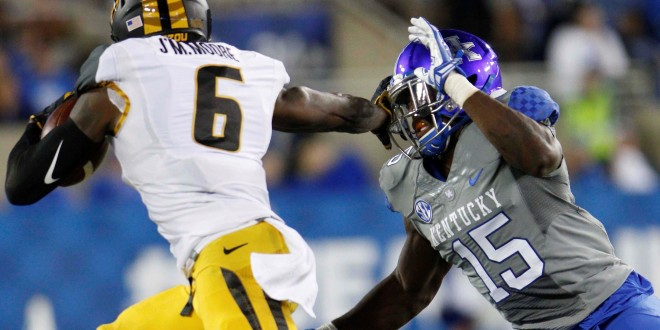 Sep 26, 2015; Lexington, KY, USA; Missouri Tigers wide receiver J'Mon Moore (6) runs the ball against Kentucky Wildcats safety Marcus McWilson (15) in the second half at Commonwealth Stadium. Kentucky defeated Missouri 21-13. Mandatory Credit: Mark Zerof-USA TODAY Sports