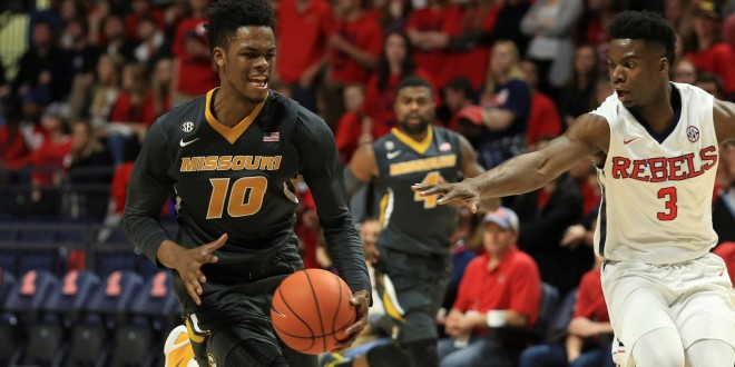 Feb 23, 2016; Oxford, MS, USA; Missouri Tigers guard K.J. Walton (10) brings the ball up court while guarded by Mississippi Rebels guard Terence Davis (3) during the second half at The Pavilion at Ole Miss. Mississippi Rebels defeats the Missouri Tigers 85-76.  Mandatory Credit: Spruce Derden-USA TODAY Sports
