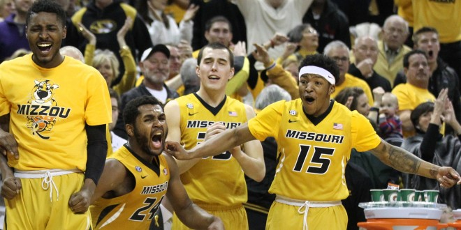 Feb 13, 2016; Columbia, MO, USA; Missouri Tigers forward D'Angelo Allen (from left) and forward Kevin Puryear (24) and guard Cullen VanLeer (33) and guard Wes Clark (15) cheer during the second half of a game against the Tennessee Volunteers at Mizzou Arena. The Tigers won 75-64. Mandatory Credit: Timothy Tai-USA TODAY Sports