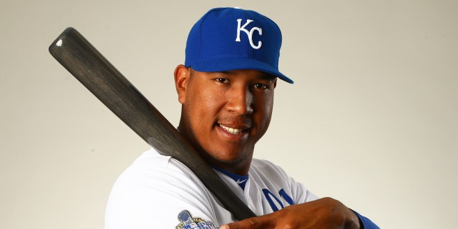 Feb 25, 2016; Surprise, AZ, USA; Kansas City Royals catcher Salvador Perez points at the World Series champions patch on his jersey as he poses for a portrait during photo day at Surprise Stadium. Mandatory Credit: Mark J. Rebilas-USA TODAY Sports