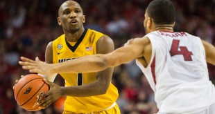 Feb 20, 2016; Fayetteville, AR, USA; Missouri Tigers guard Terrence Phillips (1) looks for a pass while being guarded by Arkansas Razorbacks guard Jabril Durham (4) in the second half at Bud Walton Arena. The Razorbacks won 84-72. Mandatory Credit: Gunnar Rathbun-USA TODAY Sports