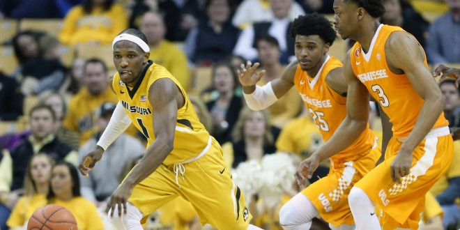 Feb 13, 2016; Columbia, MO, USA; Missouri Tigers guard Terrence Phillips (1) takes the ball past Tennessee Volunteers guard Shembari Phillips (25) and guard Robert Hubbs III (3) during the second half of a game at Mizzou Arena. The Tigers won 75-64. Mandatory Credit: Timothy Tai-USA TODAY Sports