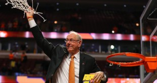 Mar 27, 2016; Chicago, IL, USA; Syracuse Orange head coach Jim Boeheim waves to the crowd after cutting down the net after defeating the Virginia Cavaliers in the championship game of the midwest regional of the NCAA Tournament at the United Center. Mandatory Credit: Dennis Wierzbicki-USA TODAY Sports