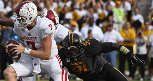 Sep 20, 2014; Columbia, MO, USA; Missouri Tigers defensive lineman Charles Harris (91) attempts to tackle Indiana Hoosiers quarterback Nate Sudfeld (7) during the first half at Faurot Field. Mandatory Credit: Jasen Vinlove-USA TODAY Sports