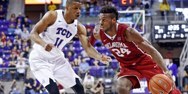 Mar 5, 2016; Fort Worth, TX, USA; Oklahoma Sooners guard Buddy Hield (24) dribbles as TCU Horned Frogs guard Brandon Parrish (11) defends during the second half at Ed and Rae Schollmaier Arena. Mandatory Credit: Kevin Jairaj-USA TODAY Sports