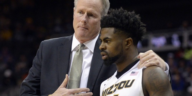 Nov 24, 2015; Kansas City, MO, USA; Missouri Tigers head coach Kim Anderson talks to guard Tramaine Isabell (4) in the second half against the Northwestern Wildcats at Sprint Center. Northwestern won the game 67-62. Mandatory Credit: John Rieger-USA TODAY Sports