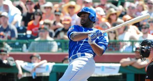 Mar 25, 2016; Scottsdale, AZ, USA; Kansas City Royals center fielder Lorenzo Cain (6) singles in the first inning against the San Francisco Giants at Scottsdale Stadium. Mandatory Credit: Matt Kartozian-USA TODAY Sports