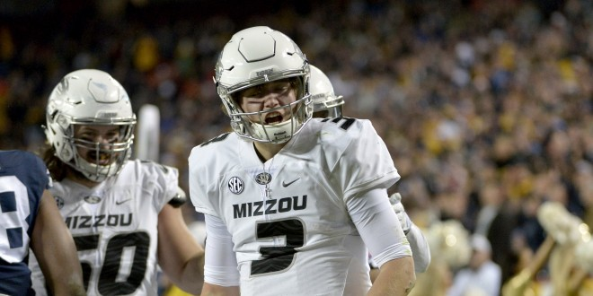 Nov 14, 2015; Kansas City, MO, USA; Missouri Tigers quarterback Drew Lock (3) celebrates after a run during the second half against the Brigham Young Cougars at Arrowhead Stadium. Missouri won 20-16. Mandatory Credit: Denny Medley-USA TODAY Sports