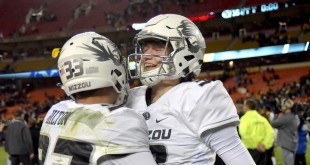 Nov 14, 2015; Kansas City, MO, USA; Missouri Tigers quarterback Drew Lock (3) celebrates with defensive back Cam Hilton (33) after the win over the Brigham Young Cougars at Arrowhead Stadium. Missouri won 20-16. Mandatory Credit: Denny Medley-USA TODAY Sports