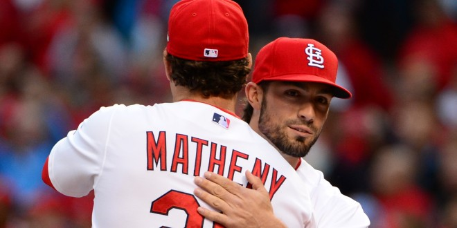 Oct 9, 2015; St. Louis, MO, USA; St. Louis Cardinals manager Mike Matheny (26) and teammate embrace before game one of the NLDS against the Chicago Cubs at Busch Stadium. Mandatory Credit: Jeff Curry-USA TODAY Sports