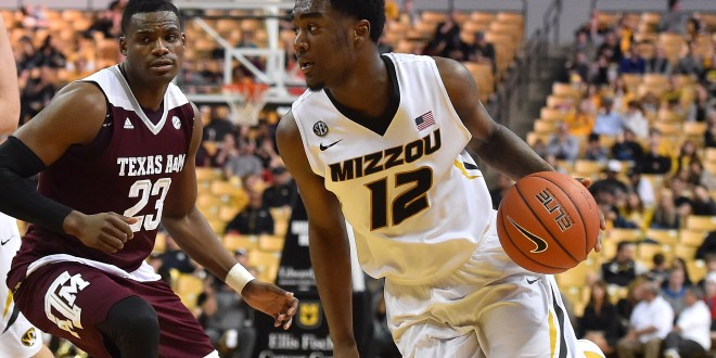 Feb 27, 2016; Columbia, MO, USA; Missouri Tigers guard Namon Wright (12) dribbles the ball around Texas A&M Aggies guard Danuel House (23) during the second half at Mizzou Arena. The Aggies won 84-69.  Mandatory Credit: Jasen Vinlove-USA TODAY Sports