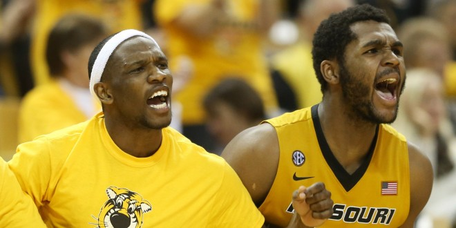 Feb 13, 2016; Columbia, MO, USA; Missouri Tigers forward D'Angelo Allen (from left), guard Terrence Phillips and forward Kevin Puryear (24) cheer during the first half of a game at Mizzou Arena. Mandatory Credit: Timothy Tai-USA TODAY Sports