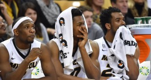 Feb 27, 2016; Columbia, MO, USA; Missouri Tigers guard Terrence Phillips (L) and K.J. Walton (C) and Kevin Puryear (R) sit on the bench against the Texas A&M Aggiesduring the second half at Mizzou Arena. The Aggies won 84-69.  Mandatory Credit: Jasen Vinlove-USA TODAY Sports