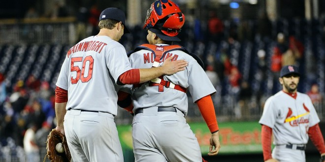 Apr 17, 2014; Washington, DC, USA; St. Louis Cardinals starting pitcher Adam Wainwright (5) is congratulated by St. Louis Cardinals catcher Yadier Molina (4) after recording the final out against the Washington Nationals at Nationals Park. Mandatory Credit: Brad Mills-USA TODAY Sports