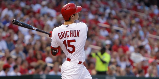 Jul 24, 2015; St. Louis, MO, USA; St. Louis Cardinals left fielder Randal Grichuk (15) follows through on his two run home run during the second inning of a baseball game against the Atlanta Braves at Busch Stadium. Mandatory Credit: Scott Kane-USA TODAY Sports