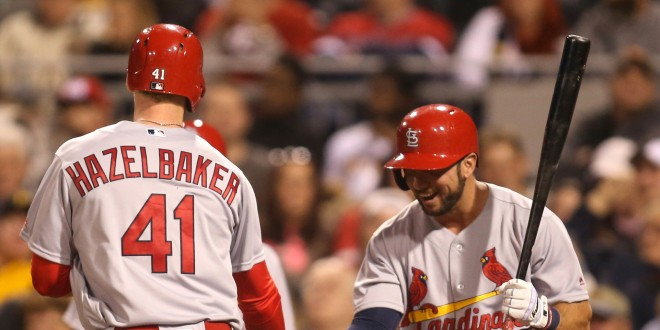 Apr 6, 2016; Pittsburgh, PA, USA; St. Louis Cardinals center fielder Jeremy Hazelbaker (41) is greeted at home plate by shortstop Greg Garcia (35) after Hazelbaker hit  a solo home run against the Pittsburgh Pirates during the sixth inning at PNC Park. Mandatory Credit: Charles LeClaire-USA TODAY Sports