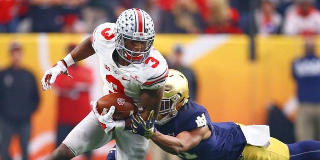 Jan 1, 2016; Glendale, AZ, USA; Ohio State Buckeyes wide receiver Michael Thomas (3) is tackled by diving Notre Dame Fighting Irish cornerback Nick Watkins (21) in the second half during the 2016 Fiesta Bowl at University of Phoenix Stadium. The Buckeyes defeated the Fighting Irish 44-28. Mandatory Credit: Mark J. Rebilas-USA TODAY Sports