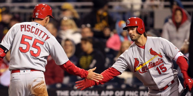Apr 5, 2016; Pittsburgh, PA, USA; St. Louis Cardinals right fielder Stephen Piscotty (55) is greeted by left fielder Randal Grichuk (15) after scoring a run against the Pittsburgh Pirates during the fifth inning at PNC Park. Mandatory Credit: Charles LeClaire-USA TODAY Sports