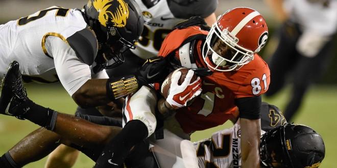 Oct 17, 2015; Athens, GA, USA; Georgia Bulldogs wide receiver Reggie Davis (81) is tackled by Missouri Tigers linebacker Donavin Newsom (25) and linebacker Terez Hall (24) during the second half at Sanford Stadium. Georgia defeated Missouri 9-6. Mandatory Credit: Dale Zanine-USA TODAY Sports